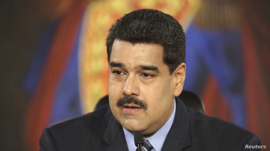 Venezuela's President Nicolas Maduro speaks during a meeting at Miraflores Palace, in Caracas, in this handout picture provided by Miraflores Palace, Feb. 17, 2016.
