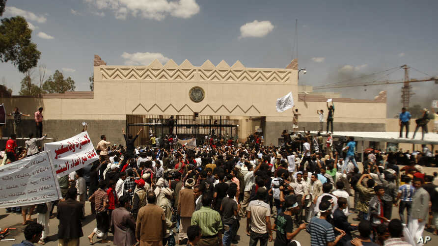 Yemenis protest in front of the U.S. Embassy during a protest about a film ridiculing Islam's Prophet Mohammed, Sanaa, Yemen, September 13, 2012.