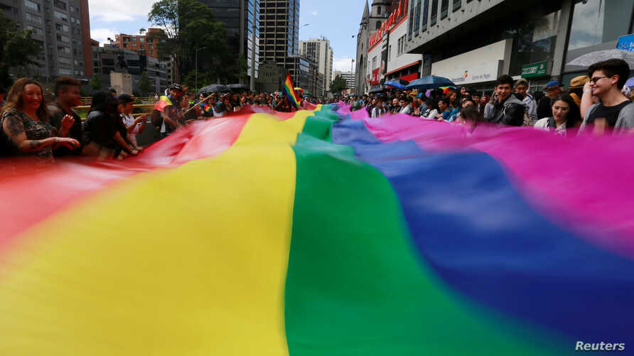 FILE - People attend an annual gay pride parade in Bogota, Colombia, July 3, 2016.