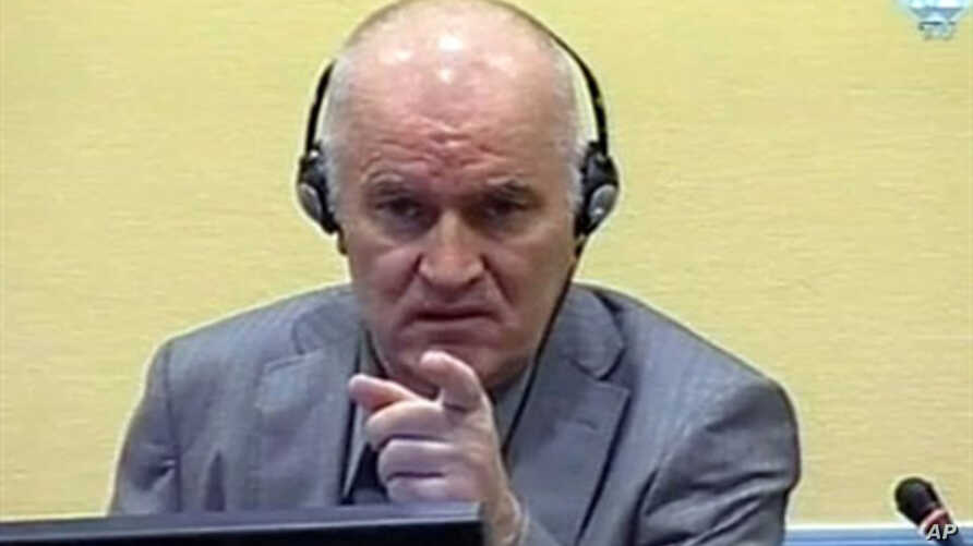 Wartime Bosnian Serb army chief Ratko Mladic gestures at his long-awaited first appearance before a U.N. judge in The Hague, June 3, 2011