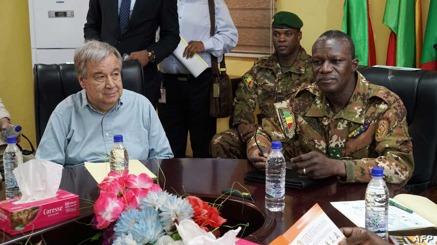 United Nations Secretary-General Antonio Guterres (L) sits next to Malian Army General Didier Dacko, Force Commander of the G5 Sahel, an institutional framework for coordination of regional cooperation in development policies and security matters in