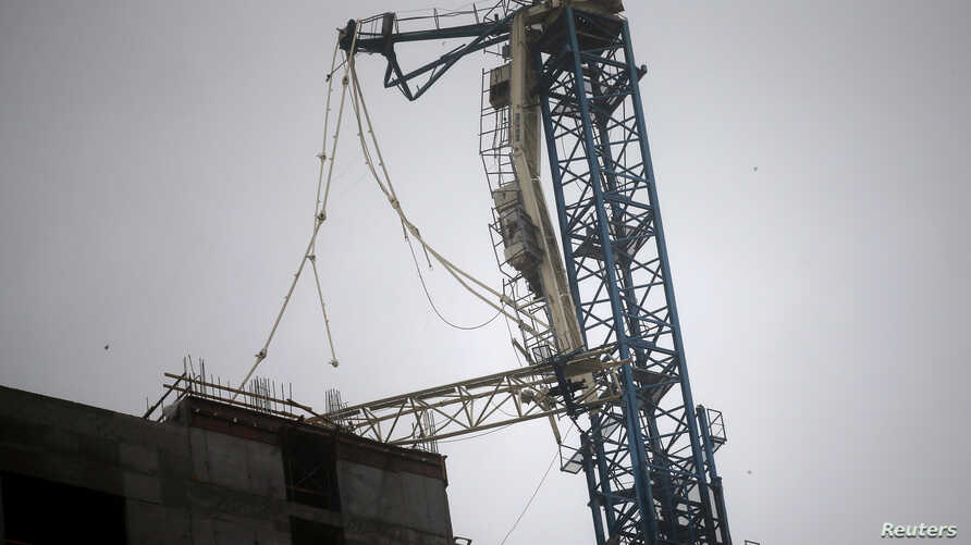 A collapsed construction crane is seen in Downtown Miami as Hurricane Irma arrives at south Florida, Sept. 10, 2017.