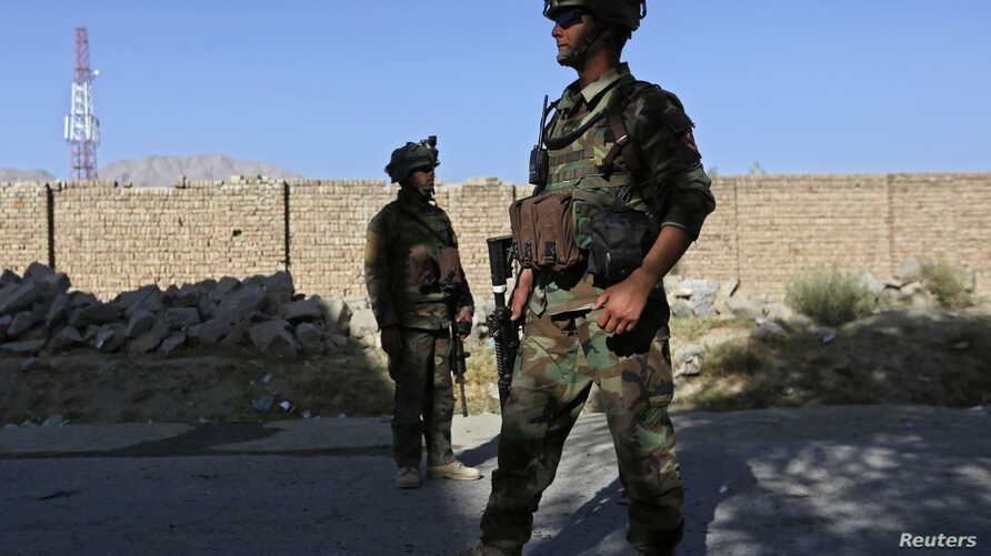 Afghan security forces inspect the site of a suicide bomb attack in Kabul, October 2, 2014.
