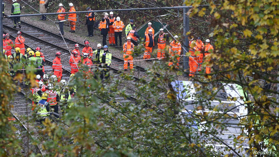 Members of the emergency services work next to a tram after it overturned injuring and trapping some passengers in Croydon, south London, Britain, Nov. 9, 2016.