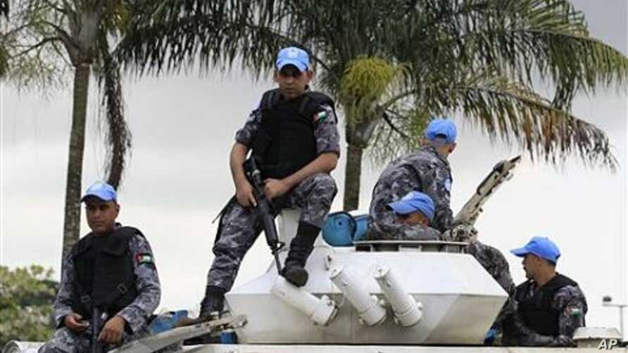UN peacekeepers from Jordan stand guard at the entrance to the Golf Hotel in Abidjan, Ivory Coast, (File Photo)