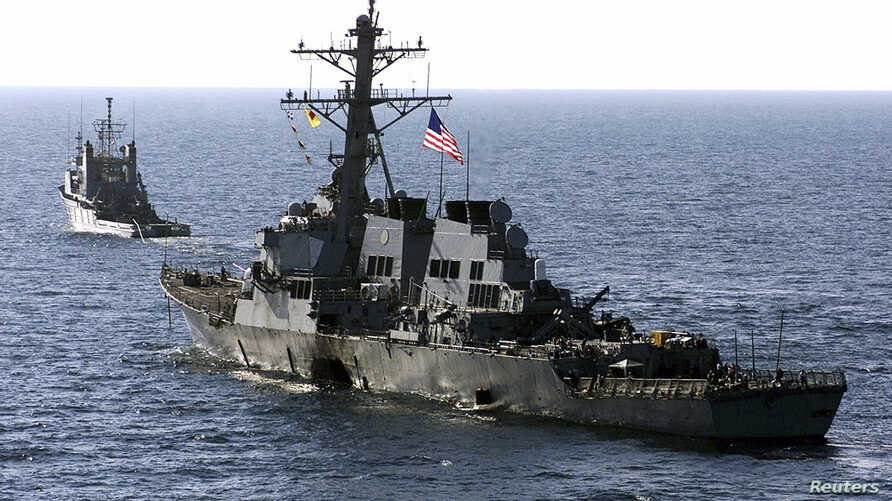 FILE - The U.S. Navy destroyer USS Cole (DDG 67) is towed away from the port city of Aden, Yemen, into open sea by the Military Sealift Command ocean-going tug USNS Catawba (T-ATF 168), Oct. 29, 2000.