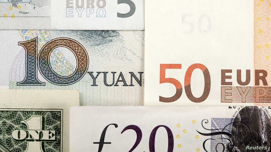 FILE - A  picture illustration shows an arrangement of various world currencies including Chinese Yuan, US Dollar, Euro, British Pound.
