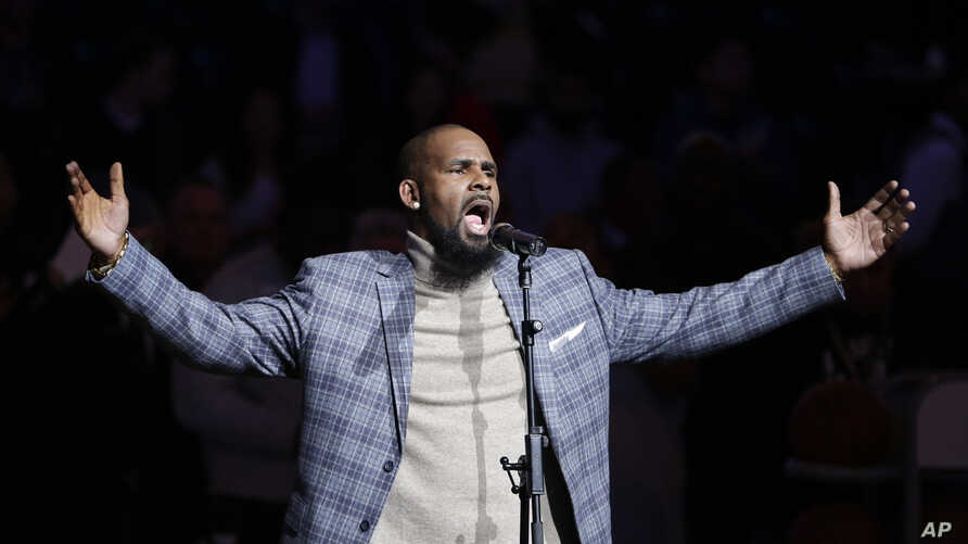 FILE - Musical artist R. Kelly performs the national anthem before an NBA basketball game between the Brooklyn Nets and the Atlanta Hawks in New York.