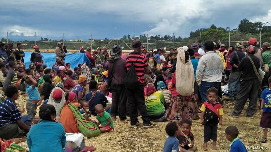 People displaced by an earthquake gather at a relief center in the central highlands of Papua New Guinea, March 1, 2018.