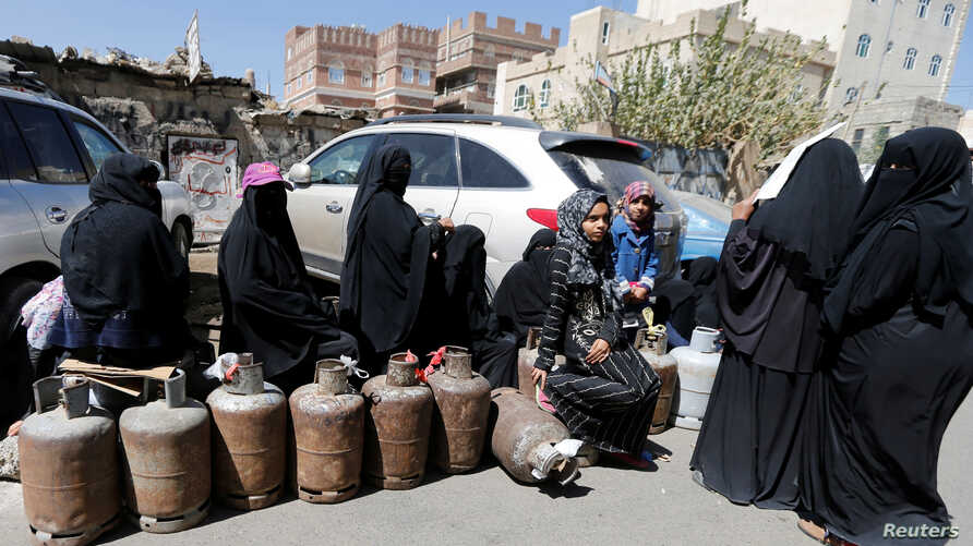 Women wait to fill up cooking gas cylinders outside a gas station amid supply shortage in Sanaa, Yemen, Nov. 7, 2017.
