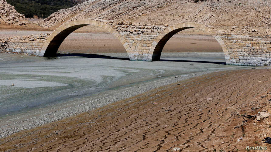 FILE - The dried, cracked bed of the Qaraoun artificial lake is seen in West Bekaa, Lebanon, Sept. 19, 2014.