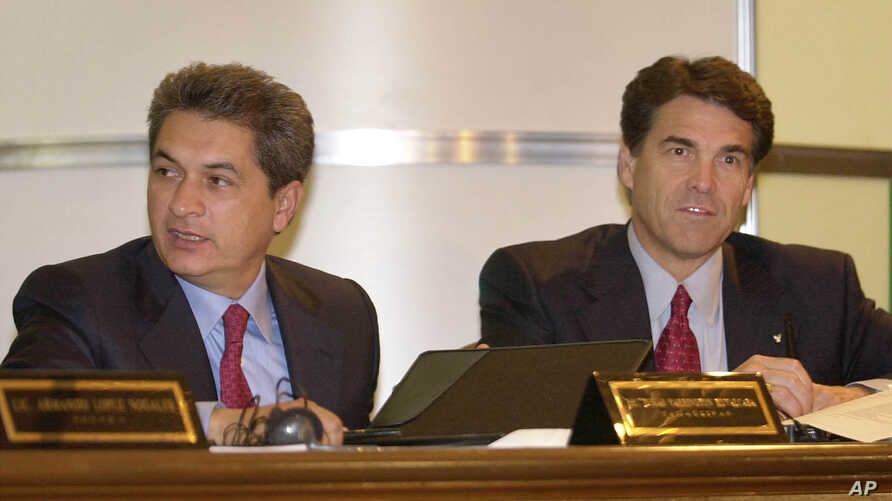 FILE - Tamaulipas Governor Tomas Yarrington, left, and Texas Governor Rick Perry are seen at the end of the XXIth Border Governors Conference in Chihuahua, Mexico, Aug. 8, 2003.