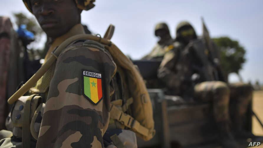 Senegalese soldiers membrers of ECOWAS forces (Economic Community of West African States) patrol in Barra, Jan. 22, 2017.