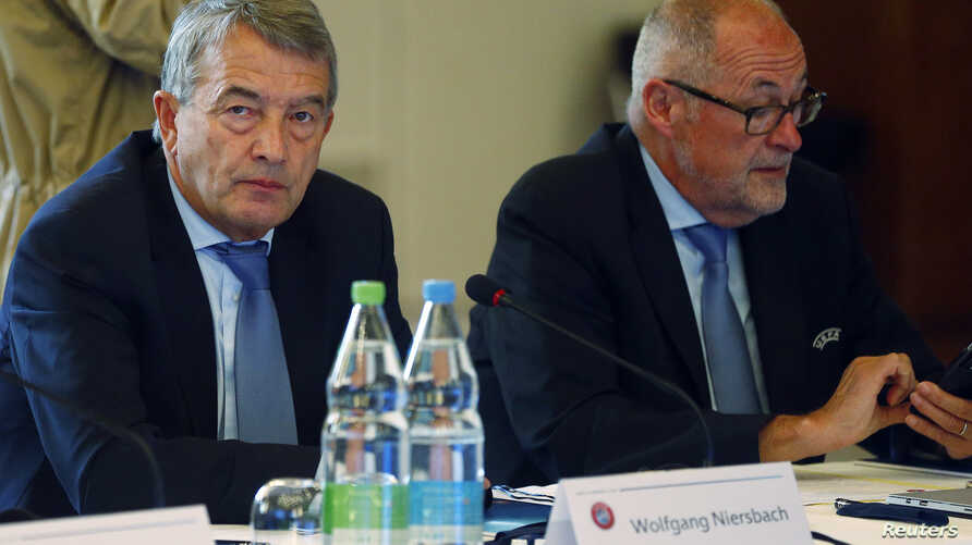 UEFA executive committee member Wolfgang Niersbach and Chairman of Swiss Football Association Peter Gillieron (R) attend the UEFA executive committee meeting in Basel, Switzerland May 18, 2016.