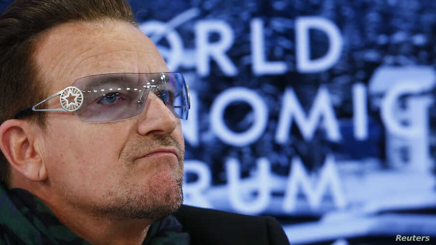 Singer Bono attends a session at the annual meeting of the World Economic Forum (WEF) in Davos, Switzerland, Jan. 24, 2014.