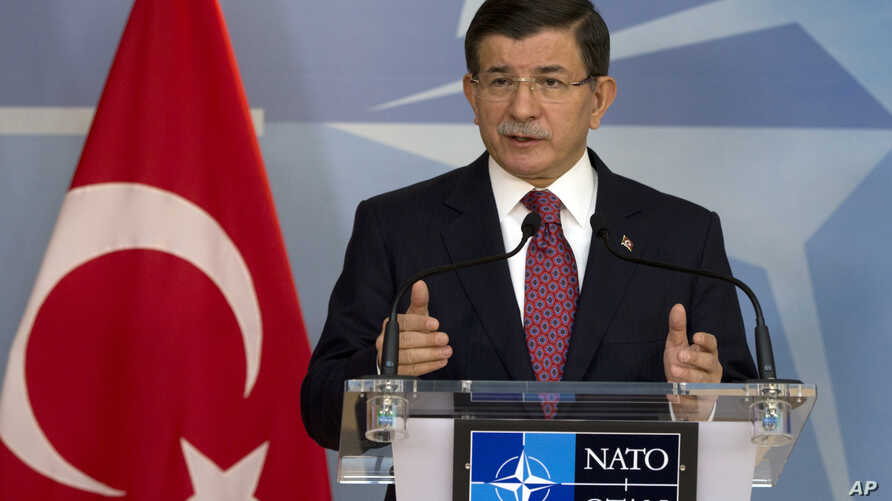 Turkish Prime Minister Ahmet Davutoglu speaks during a media conference at NATO headquarters in Brussels on Nov. 30, 2015.