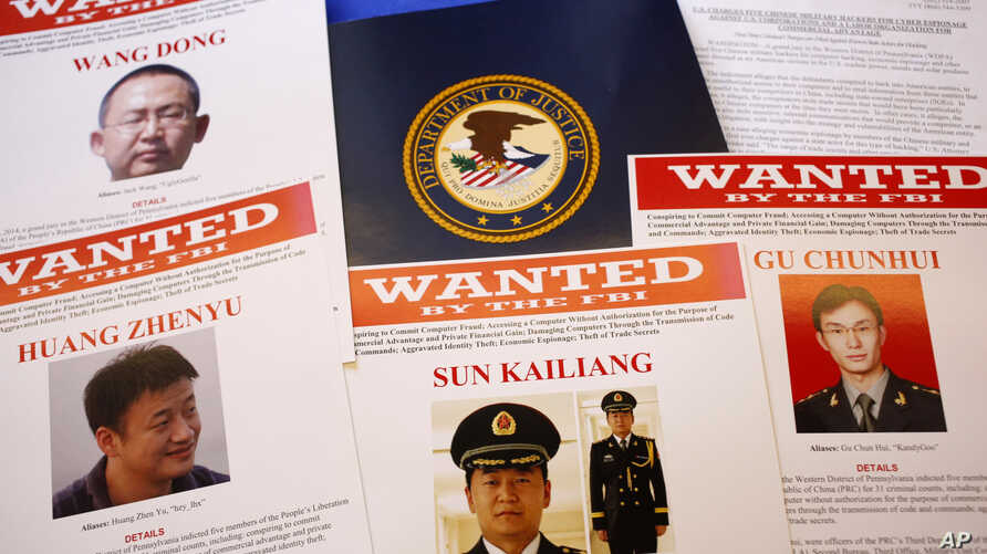 Press materials are displayed on a table of the Justice Department in Washington, May 19, 2014, before Attorney General Eric Holder was to speak at a news conference.