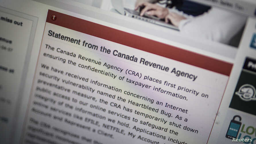 """The Canada Revenue Agency website is seen on a computer screen displaying information about an Internet security vulnerability called the """"Heartbleed Bug,"""" in Toronto, April 9, 2014."""