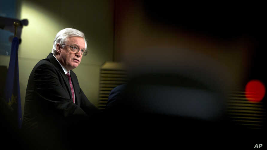 British Secretary of State for Exiting the European Union David Davis speaks during a media conference at EU headquarters in Brussels, March 19, 2018.