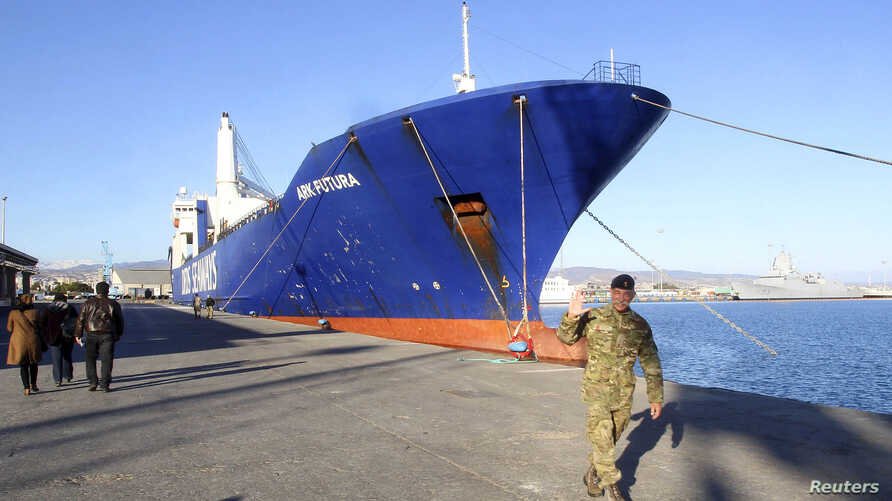 One of two cargo ships intended to take part in a Danish-Norwegian mission to transport chemical agents out of Syria docks in Limassol, Dec. 14, 2013.