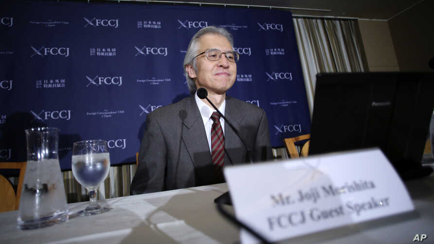 FILE - Joji Morishita, Japan's commissioner to the International Whaling Commission (IWC), looks at his computer during a press conference in Tokyo, Nov. 28, 2014.