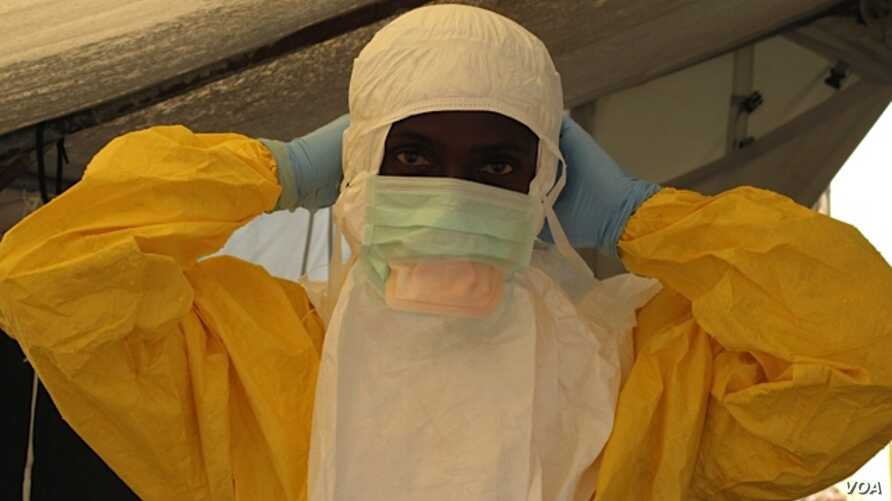 A health worker adjusts protective gear at a Doctors Without Borders' Ebola treatment unit in Conakry, Guinea.