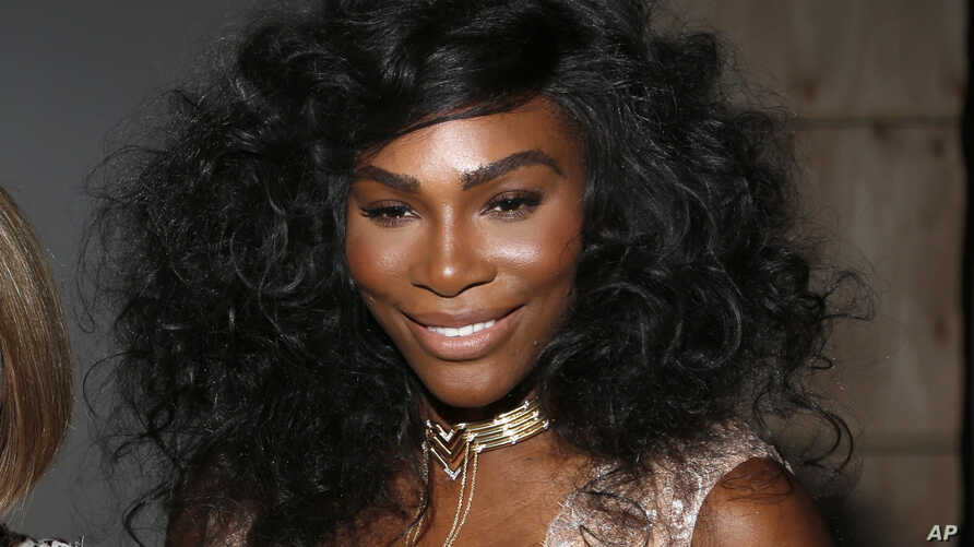 FILE - Serena Williams poses for a picture before the Serena Williams Signature Statement Spring 2017 collection is modeled during Fashion Week in New York.