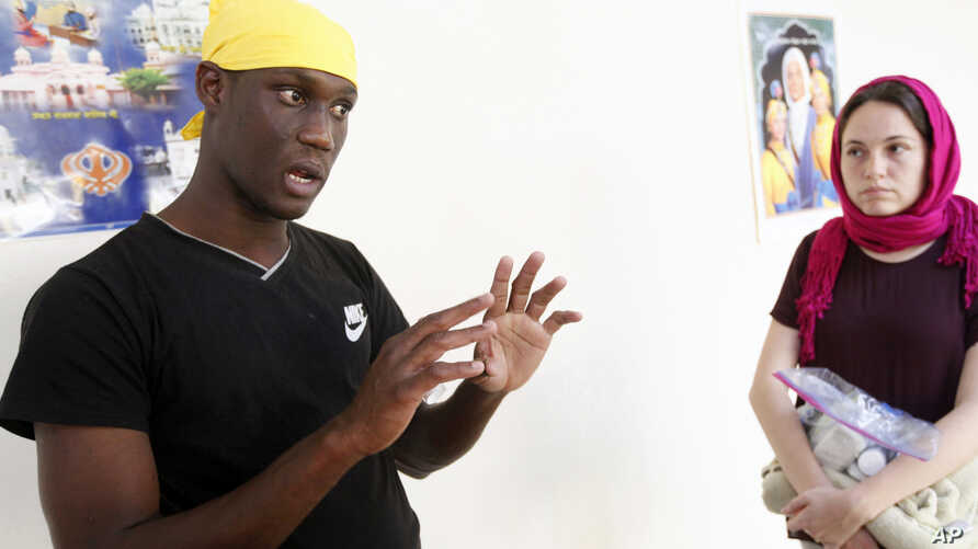 FILE - Abdoulaye Camara relates the story of his journey from Mauritania to Mexico, Oct. 3, 2018,  at the Dasmesh Darbar Sikh temple in Salem, Ore.