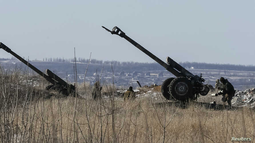 Cannons of the Ukrainian armed forces are seen at their positions near Debaltseve, eastern Ukraine, Feb. 17, 2015.