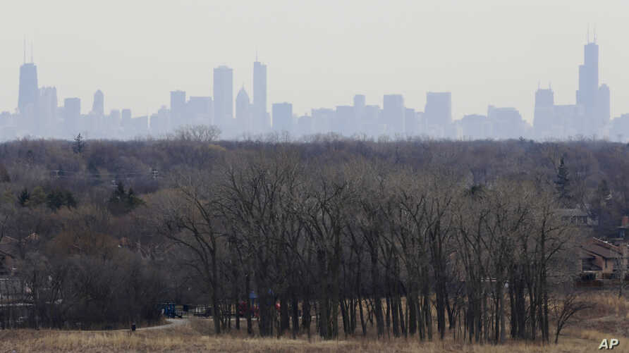 FILE - In this March 19, 2015, file photo, a thick haze of smog looms over the skyline of Chicago. A new study in the Proceedings of the National Academy of Sciences finds that America's nitrogen oxides levels, a key ingredient in smog, aren't fallin