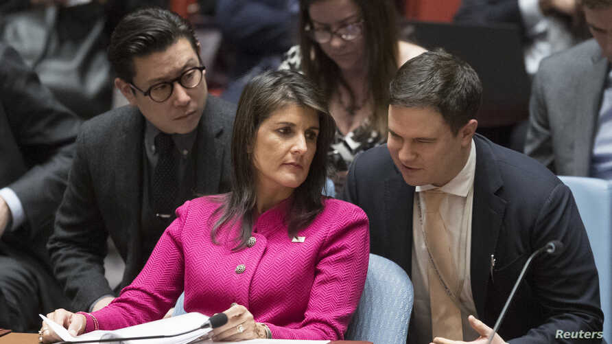 U.S. Ambassador to the United Nations Nikki Haley speaks to an aide before a Security Council meeting on the situation between Britain and Russia, April 18, 2018 at United Nations headquarters.