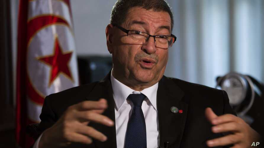 Tunisian Prime Minister Habib Essid speaks with The Associated Press during an interview ahead of a two-day conference in Madrid on combating the type of terrorism targeting foreign tourists that has hit his country twice over the last year, Spain, T