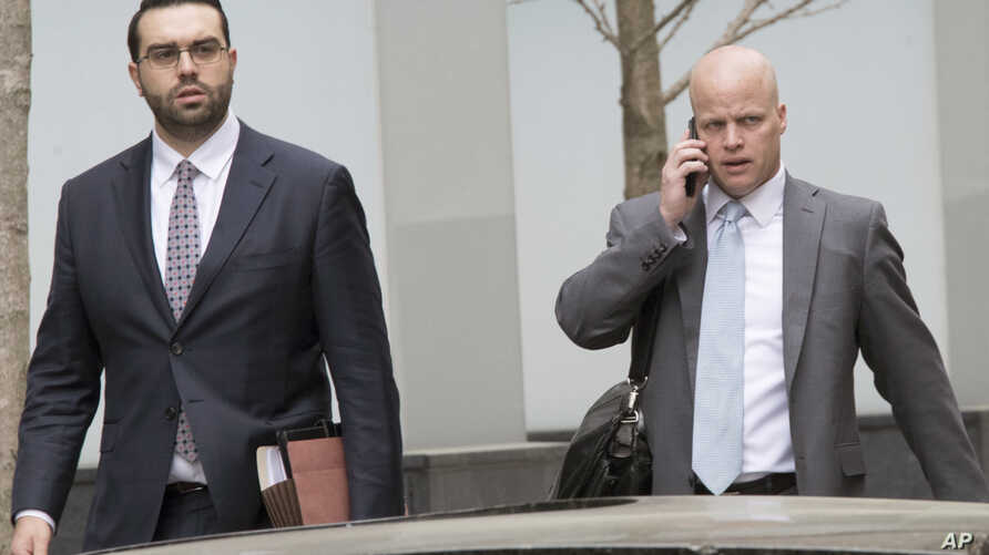Michael Cohen's attorneys Todd Harrison (R) and Joseph Evans arrive at Federal court, April 13, 2018, in New York.