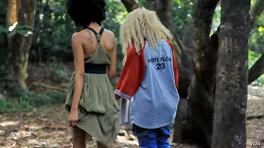 """Two women walk side-by-side in a YouTube screen grab from the controversial """"Same Love"""" remix by Kenyan recording artists Art Attack and Nicole Florence Kutoto."""