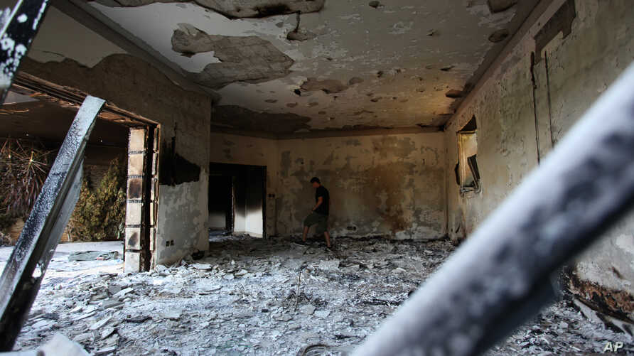 A Libyan man walks in the rubble of the damaged  U.S. consulate, after an attack that killed four Americans, including Ambassador Chris Stevens on the night of Tuesday, Sept. 11, 2012, in Benghazi, Libya, Thursday, Sept. 13, 2012.  The American ambas