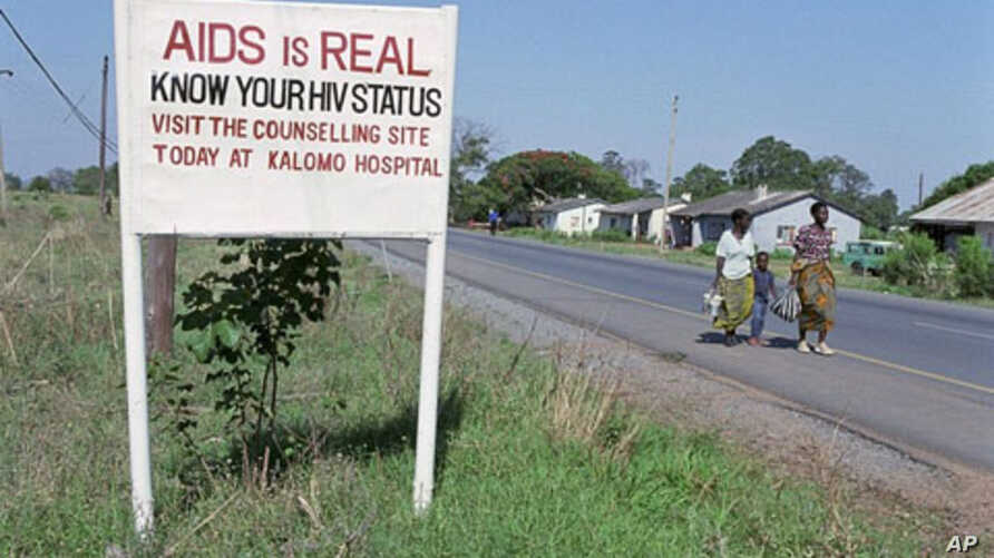 Road sign in Zambia urging AIDS awareness.