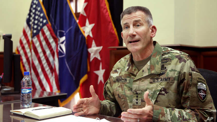 Head of NATO and U.S. forces in Afghanistan, U.S. Army Gen. John W. Nicholson, speaks during an interview, in Kabul, July 27, 2016. Nicholson's recent comments concerning Russian, Iran and Taliban has prompted a promise of a probe by the Afghan Senat
