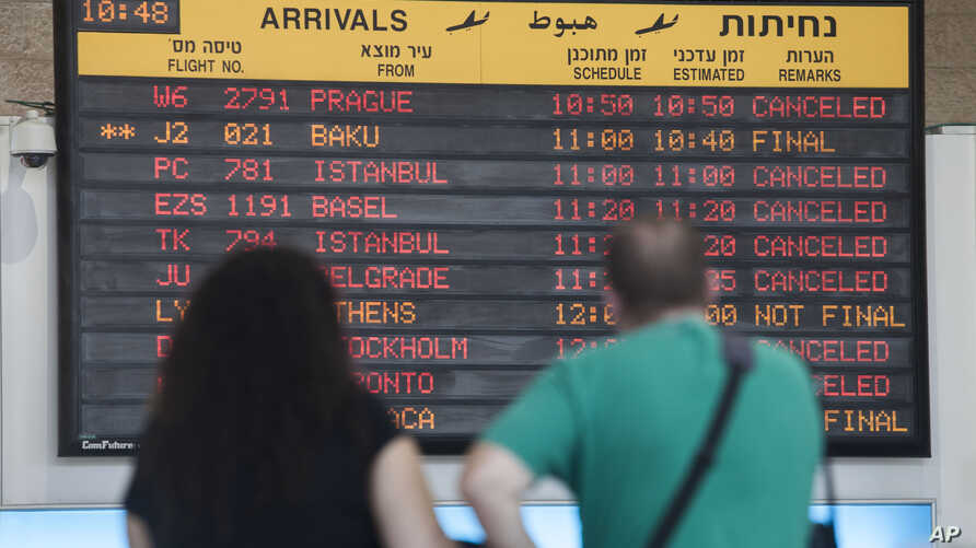 Arrival flight board displays various canceled and delayed flights in Ben Gurion International airport a day after the U.S. Federal Aviation Administration imposed a 24-hour restriction on flights after a Hamas rocket landed Tuesday within a mile of
