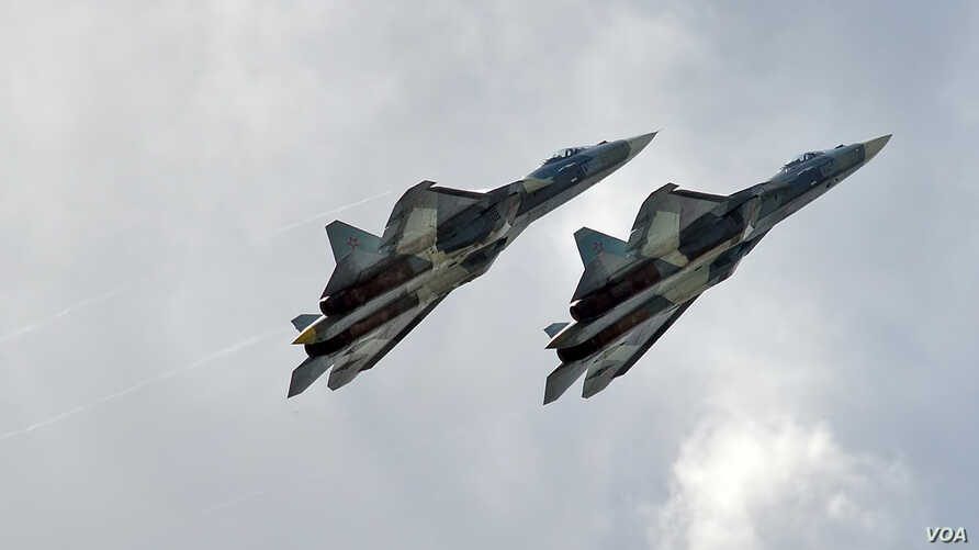 Two Russian Air Force Sukhoi SU-57 warplanes are seen in a July 23, 2017, photo.