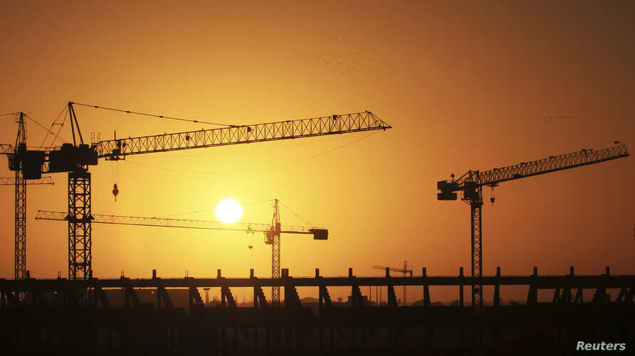 Cranes operate at the site of the football stadium in Benghazi, Libya, Jan. 19, 2013.