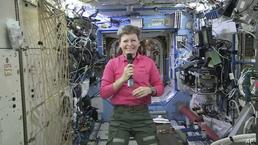 FILE - NASA, astronaut Peggy Whitson speaks during an interview aboard the International Space Station.