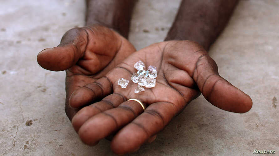 FILE - Illegal diamonds from Zimbabwe are displayed for sale in Manica, Mozambique.