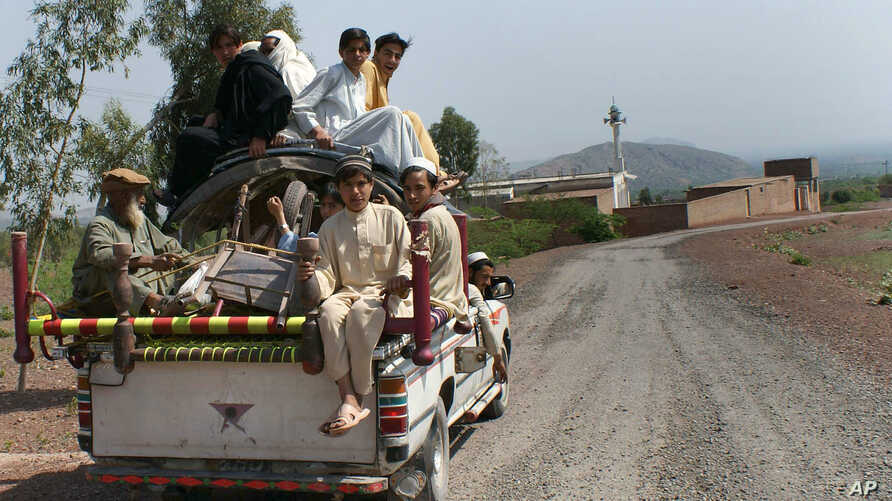 A family flees from neighboring Orakzai tribal region because of fighting between security forces and militants, March 27, 2010. A suicide bomber attacked a crowded festival and market in the region Friday.