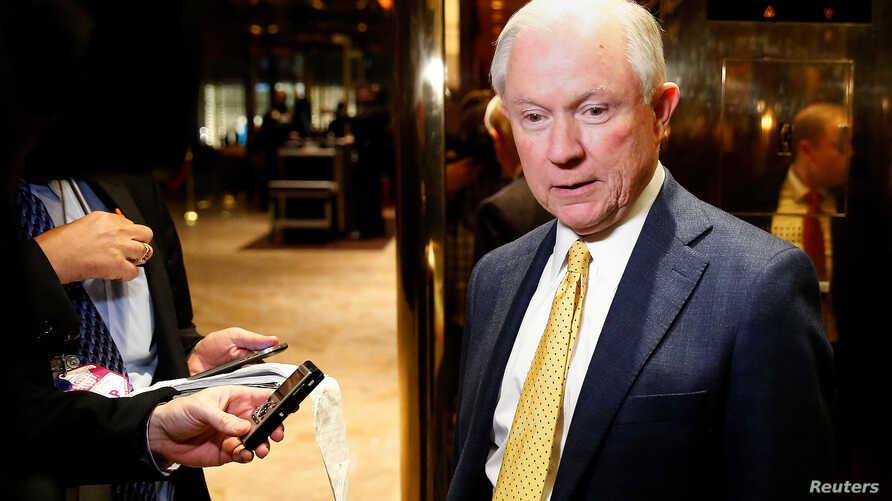 FILE - Senator Jeff Sessions (R-AL) arrives in the lobby of Republican president-elect Donald Trump's Trump Tower in New York.
