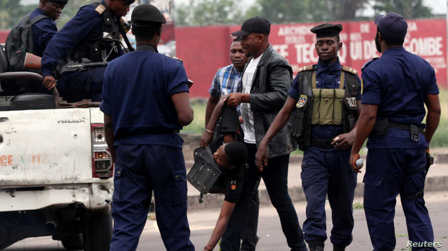 A policeman detains a demonstrator during a protest organized by Catholic activists in Kinshasa, Democratic Republic of Congo, Jan. 21, 2018.