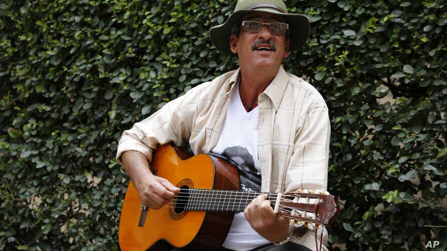 """Former rebel Julian Conrado, known as """"The FARC singer,"""" sings for students before holding a talk at the National University in Bogota, Colombia, April 27, 2017."""