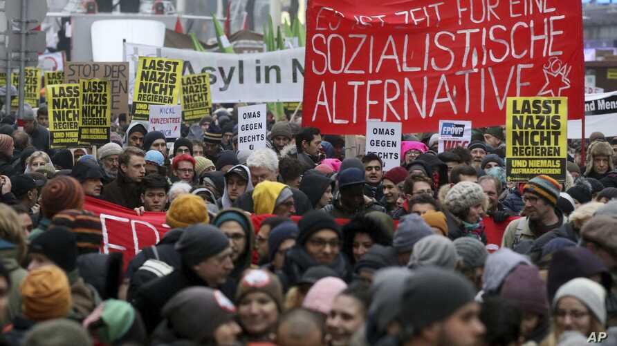 Protesters walk during a demonstration against the new Austrian government in Vienna, Austria, Jan. 13, 2018.
