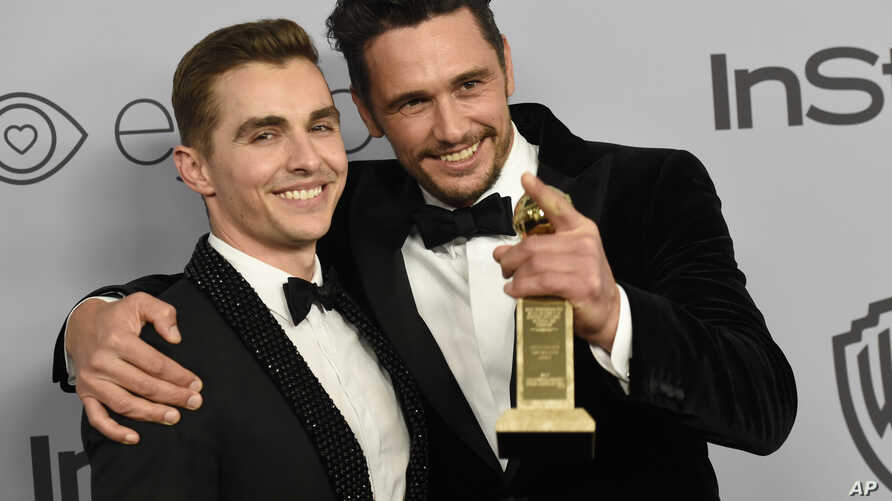 Dave Franco (L) poses with James Franco, winner of the award for best performance by an actor in a motion picture, musical, or comedy for 'The Disaster Artist,' at the InStyle and Warner Bros. Golden Globes after-party in Beverly Hills, Calif., Jan.