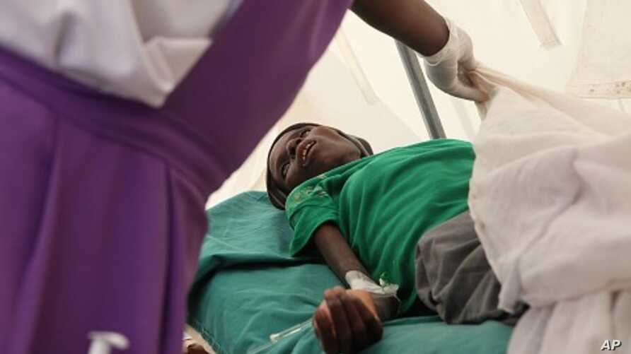 A patient suffering from HIV is taken to a local hospital in Harare, January 31, 2012.