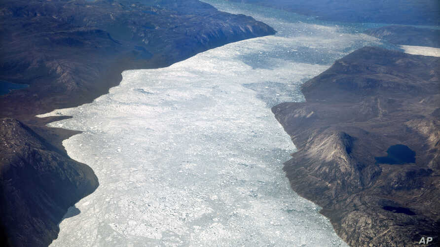 Icebergs float into a fjord off the Greenland ice sheet in southeastern Greenland, Aug. 3, 2017. The Greenland ice sheet, the second largest body of ice in the world which covers roughly 80 percent of the country, has been melting and its glaciers re